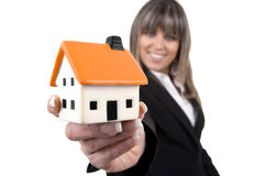 Woman holding a small house Royalty Free Stock Images