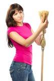 Woman housewife checking  broom Stock Photos