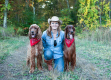 Woman with Irish Setter dogs Stock Photos