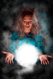 Woman with light sphere between her palms, spiritual energy Royalty Free Stock Photography