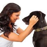Woman Looking At Dog Stock Photography