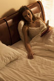 Woman lying in bed, suffering from loneliness Stock Images