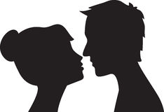 Woman and man kissing Royalty Free Stock Images