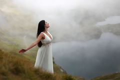 Woman in mountain mystical air Royalty Free Stock Photo