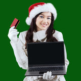 Woman online shopping to prepare xmas Royalty Free Stock Photography