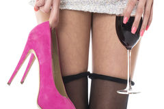 Woman Partying Holding High Heels With a Glass of Wine Royalty Free Stock Images