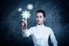 Woman Pointing at Glowing Snow Icon Royalty Free Stock Images
