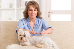 Woman practicing reiki therapy Stock Photos