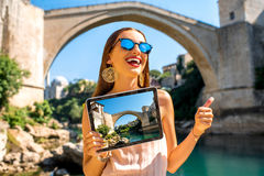 Woman promoting tourism in Mostar city Stock Photos