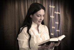 Woman reading a bible Royalty Free Stock Photography