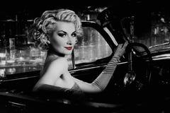 Woman  in retro car against Stock Image