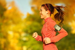 Woman runner running in fall autumn forest Royalty Free Stock Photos