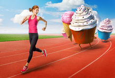 Woman running away from sweets Royalty Free Stock Images