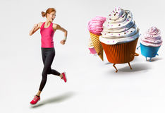 Woman running away from sweets Stock Image