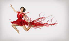 Woman Running in Jump, Girl Performer Leap Dancing in Red Dress Royalty Free Stock Image
