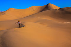 Woman is among sand dunes Royalty Free Stock Photos