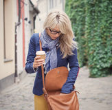 Woman searching for stuff in her handbag. Stock Photos
