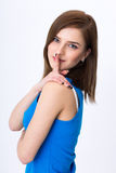 Woman with secret holding finger over lips Royalty Free Stock Photos