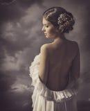 Woman fashion dress, retro hair style, naked back, historical romance portrait Stock Photos