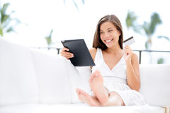 Woman shopping on tablet computer and credit card Stock Photography