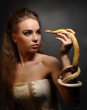 Woman with snake Stock Image