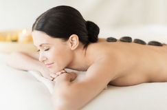 Woman in spa with hot stones Stock Images