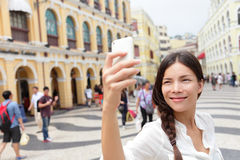Woman tourist taking selfie pictures in Macau Royalty Free Stock Photos