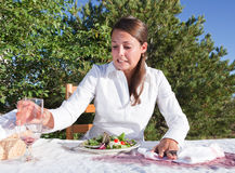 Woman trying to clean after spilling wine Stock Photo