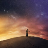Woman under night sky. Royalty Free Stock Image