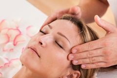 Woman undergoing acupuncture treatment Royalty Free Stock Photography