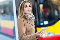 Woman Waiting at Bus Stop Stock Photography