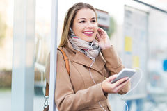Woman Waiting at Bus Stop Royalty Free Stock Images