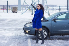 Woman waiting for roadside assistance Royalty Free Stock Photo