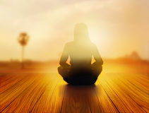Woman was meditating in sunrise and rays of light on landscape, vibrant soft and blur concept Stock Photography