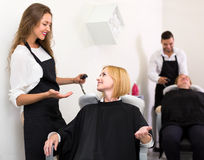 Woman washing head in beauty shop Royalty Free Stock Photography