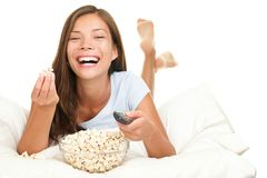 Woman watching funny movie laughing Stock Photography