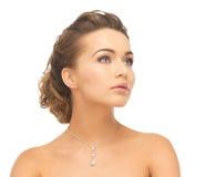 Woman wearing shiny diamond necklace Royalty Free Stock Photo