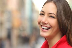 Woman white smile with a perfect teeth in the street Royalty Free Stock Photography