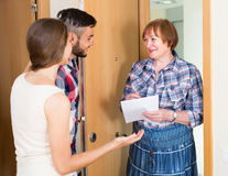 Woman and young family at door Royalty Free Stock Photo