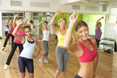 Women Taking Part In Zumba Class In Gym Stock Image