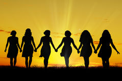 Women walking hand in hand Royalty Free Stock Images