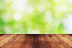 Wood table and bokeh abstract nature green background Stock Photos