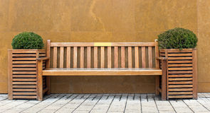 Wooden bench with bush Stock Photos