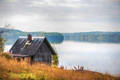 Wooden country house on lake shore Royalty Free Stock Image