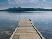 Wooden dock on a beautiful calm Yukon lake Canada Royalty Free Stock Image