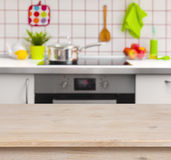 Wooden table on blurred kitchen bench background Royalty Free Stock Image