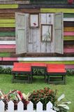 Wooden table and chairs in garden Royalty Free Stock Image