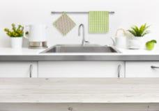 Wooden table on kitchen sink interior background Stock Photos