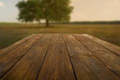 Wooden table outdoors with autumn field background Stock Image