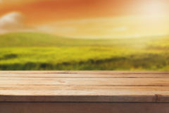 Wooden table over beautiful blur landscape background for product montage Stock Photos